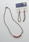 A red beads necklace andearrings